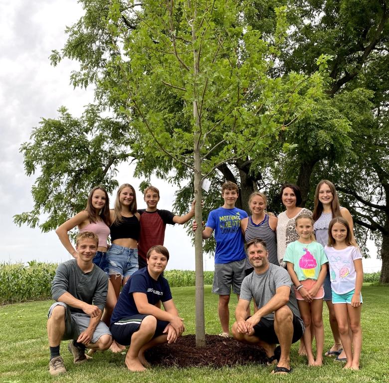 Family around donated tree
